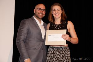 Geneviève Guay (right) accepts the award from teacher Mark Longpré