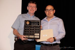 Alex Borja (right) accepts the award from Athletics Webmaster Denis Lafontaine