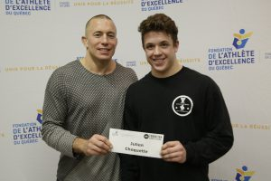 Photo: TVGO   Julien Choquette receiving his bursary from the hands of Georges St-Pierre